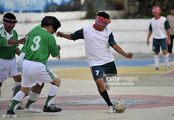 Blind athletes from the province of Pichincha and Portoviejo struggle for the ball during their indoor soccer final match on June 28 2008 in Ibarra...