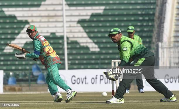 Blind Bangladeshi batsman Mohammad Mahmud Rashid plays a shot during the Blind Cricket World Cup match between Pakistan and Bangladesh at the Gaddafi...