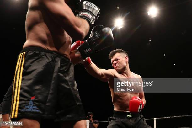 Blind boxer Zac Clarkson punches Damien Williams during David and Goliath Fight Night Both fighters are clinically blind and attached with a leg rope...