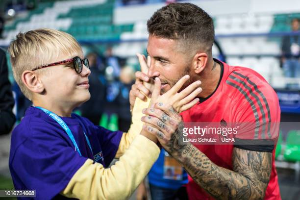TALLINN ESTONIA AUGUST A blind boy of the UEFA Foundation touches the face of Sergio Ramos of Real Madrid after Real Madrid's training session ahead...