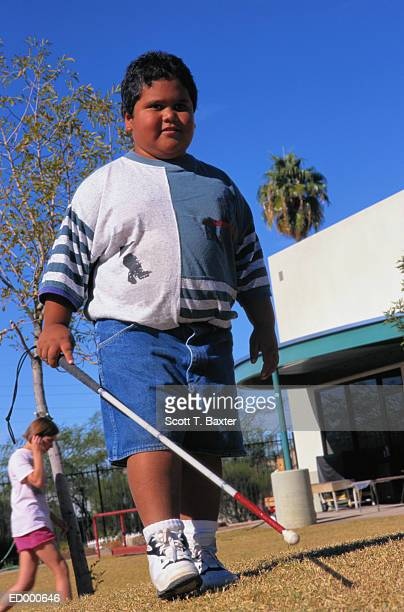 blind boy with cane - school cane stock photos and pictures