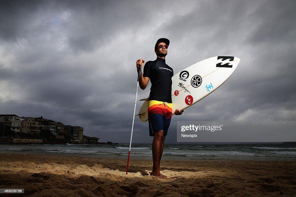Blind Brazilian surfer Derek Rabelo poses at Bondi Beach on February 9, 2015 in Sydney, Australia.