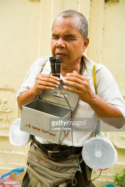 Blind busker on a Bangkok street.