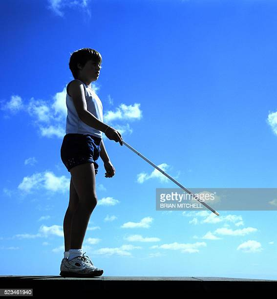 blind child using white cane - school cane stock photos and pictures