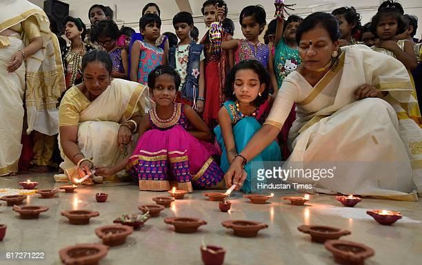 Blind children of Kamla Mehta Dadar School for the Blind, lighting earthen lamps to celebrate Diwali, on October 21, 2016 in Mumbai, India. Diwali is...