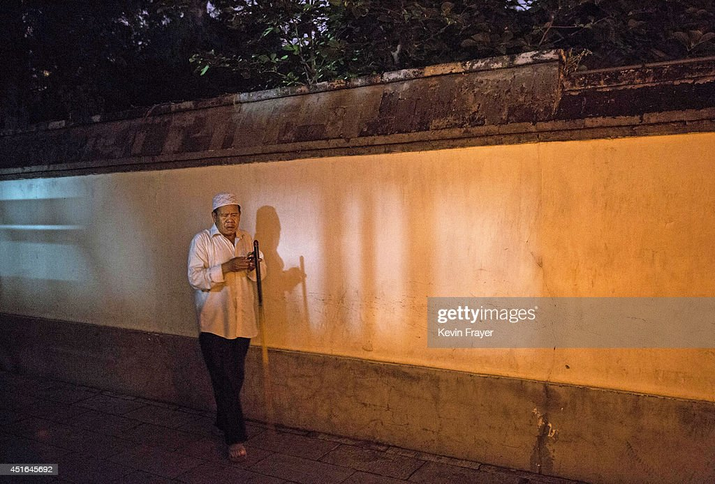 A blind Chinese Muslim of the Hui ethnic minority leaves after breaking fast during the holy fasting month of Ramadan at the historic Niujie Mosque on July 3, 2014 in Beijing, China. The Hui Muslim community, which numbers more than an estimated 10 million throughout the country, is predominantly Chinese-speaking. Muslims around the world are marking Ramadan, where the devout fast from dawn until dusk, and is a time of fasting, prayer and charitable giving.