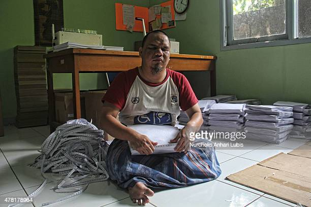 A blind count sheets Braille Quran which has been printed at a blind foundation on June 23 2015 in Tangerang Indonesia Braille Quran is the...