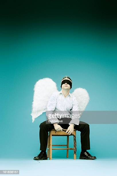 blind faith - male angel stock photos and pictures
