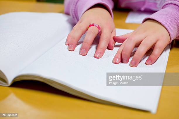 blind girl reading braille - braille stock pictures, royalty-free photos & images