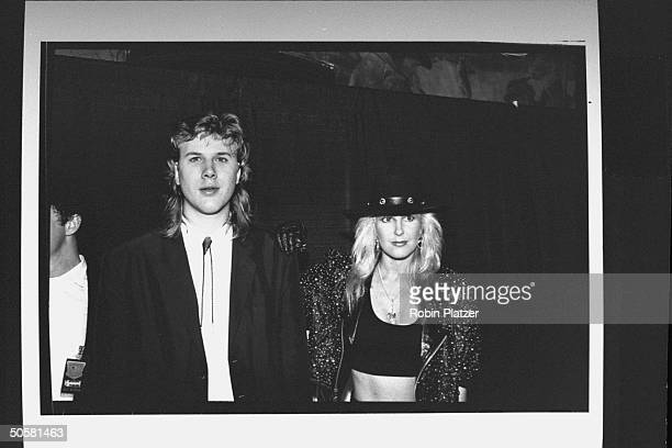 Blind guitarist Jeff Healey standing next to Lita Ford, guitarist for the rock group Ladykiller at the first annual Int'l Rock Awards ceremony.