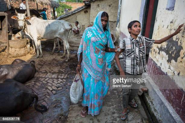 Blind Indian boy Dablu Kuma and his mother sister and grandmother at home in a remote village in Bihar India Dablu has been diagnosed with Cataracts...