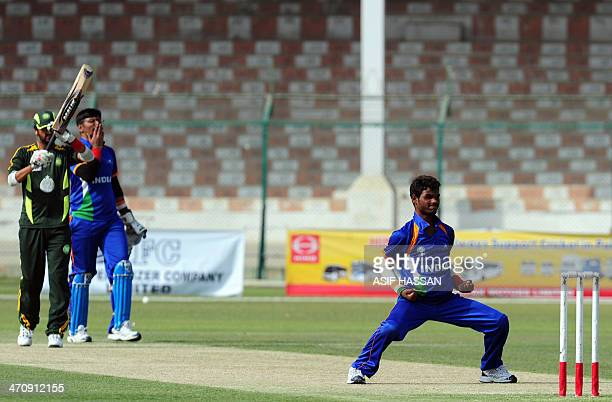 Blind Indian cricketer Sukhram celebrates after taking the wicket of Pakistani batsman Anees Javed during a oneday match between India and Pakistan's...