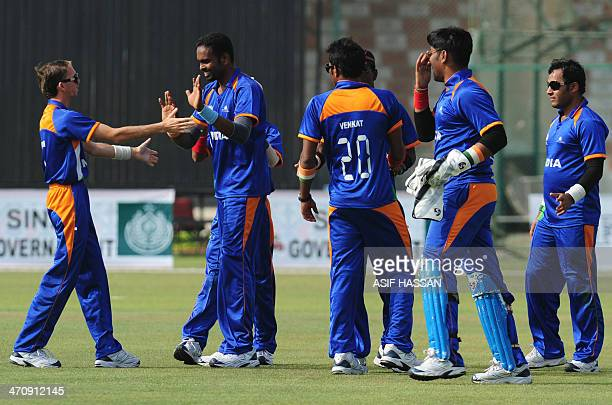 Blind Indian cricketers celebrate after the dismissal of unseen Pakistani cricketer Anees Javed during a oneday match between India and Pakistan's...