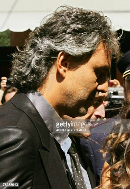 Blind Italian tenor Andrea Bocelli arrives at Modena's Romanesque cathedral 08 September 2007 to sing at the funeral mass in tribute to Italy's opera...