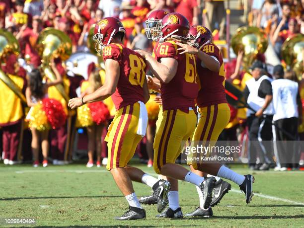 Blind long snapper Jake Olson runs off the field after snapping the ball to place kicker Chase McGrath of the USC Trojans for an extra point in the...