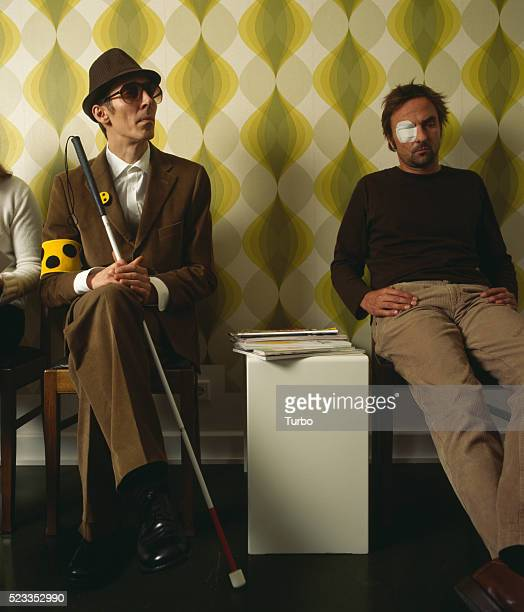 Blind man and other patients in waiting room