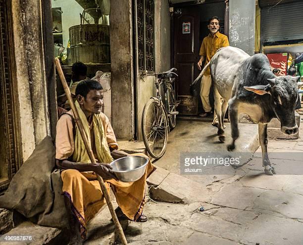 Blind man begging in the street Varanasi India