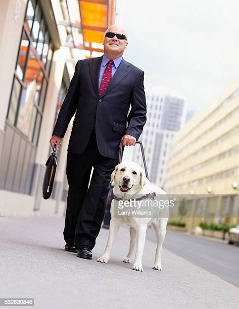 Blind Man Being Led by Guide Dog