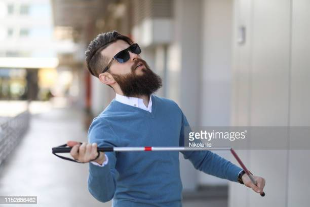 blind man outdoors - blindness stock pictures, royalty-free photos & images