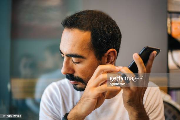 blind man using technology - braille stock pictures, royalty-free photos & images