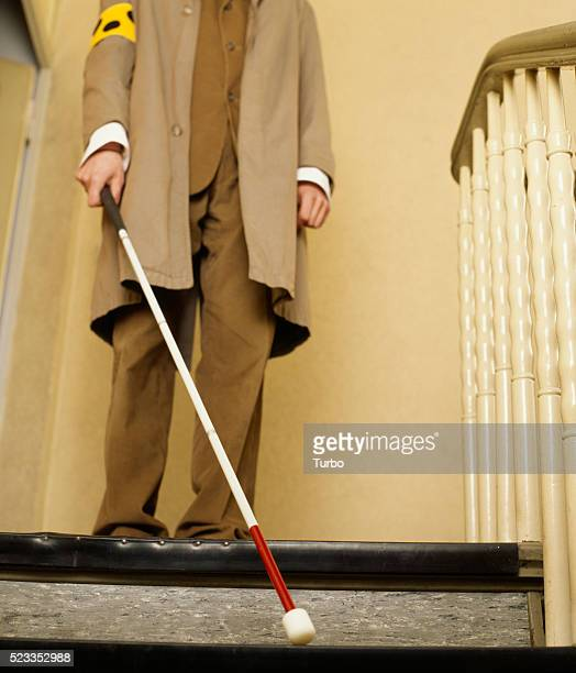 Blind man walking down stairs