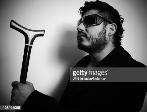 Blind Man Wearing Dark Glasses And Holding A Cane Stock
