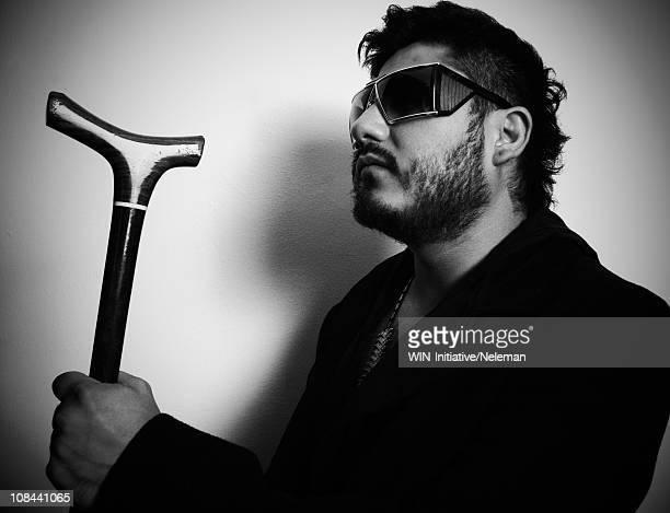 Blind man wearing dark glasses and holding a cane