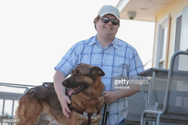 Blind man with his service dog at an outdoor cafe