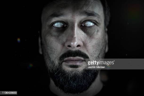 blind man with white eyes - demons stock photos and pictures