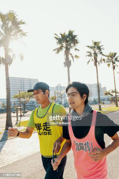 Blind marathon athlete running with his guide