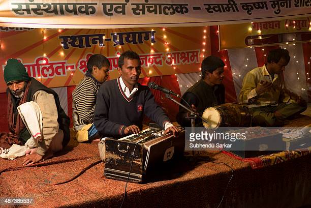 Blind men sing devotional songs at Maha Kumbh mela. Kumbh Mela is a site of mass pilgrimage in which Hindus gather at a sacred river for a holy dip....
