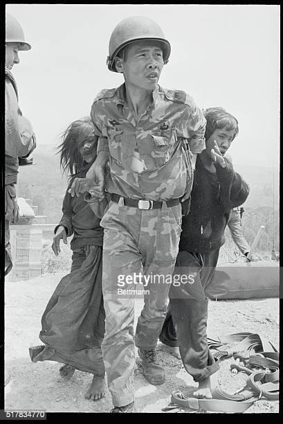Blind Montagnard Children Taken to Safety Khe Sanh South Vietnamese A South Vietnamese paratrooper leads two blind Montagnard children to an...