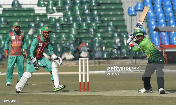 Blind Pakistani cricketer Badar Munir plays a shot during the Blind Cricket World Cup match between Pakistan and Bangladesh at the Gaddafi Cricket...