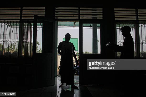 Blind people are at a blind foundation on June 23 2015 in Tangerang Indonesia During the month of ramadan they learn to read Braille Quran Braille...
