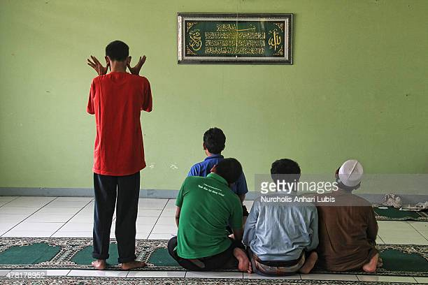 Blind people praying at a blind foundation on June 23 2015 in Tangerang Indonesia During the month of ramadan they learn to read Braille Quran During...