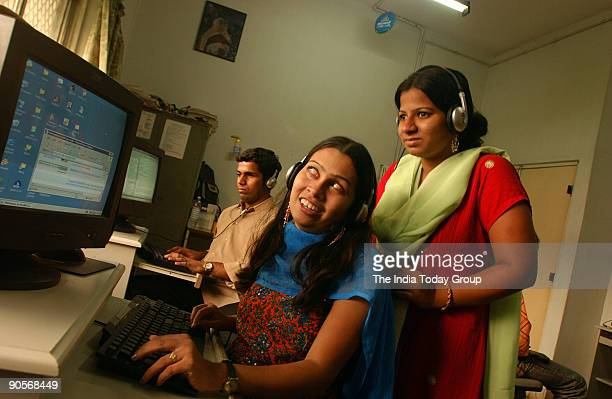 Blind people surfing the net in the cyber cafe at National Association for the Blind in Mumbai Maharashtra India