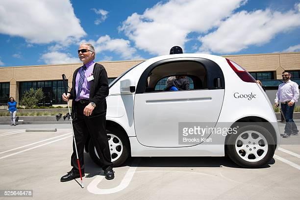 A blind person before taking a ride in the latest version of Google's selfdriving car outside the GoogleX labs in Mountain View CA The podlike...