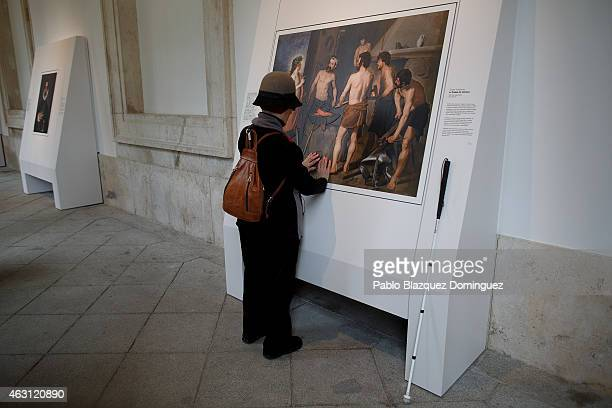 A blind person feels with her hands a copy of 'Apollo in the forge of Vulcan' of Diego Velazquez at The Prado Museum on February 10 2015 in Madrid...