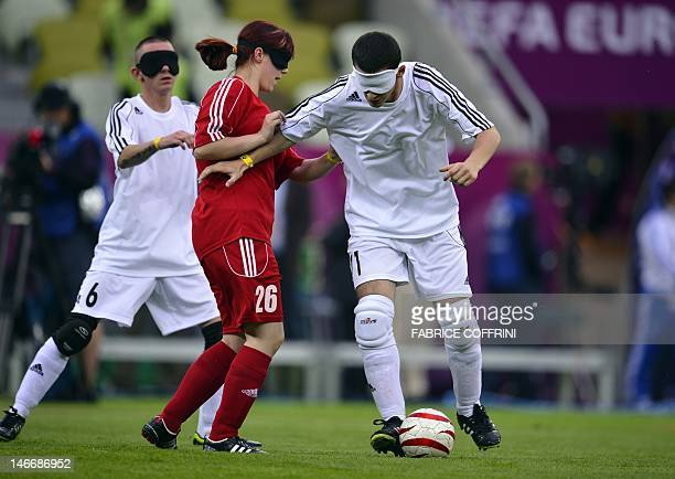 Blind players play football before the Euro 2012 football championships quarterfinal match Germany vs Greece on June 22 2012 at the Gdansk Arena AFP...