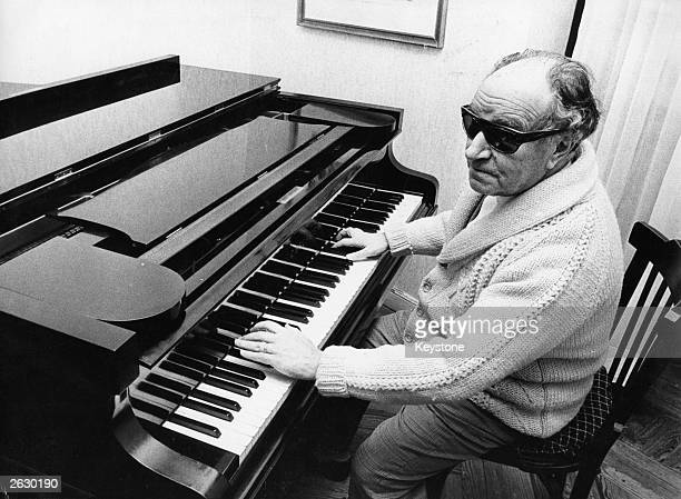 Blind Spanish composer Joaquin Rodrigo playing the piano at his home in Madrid