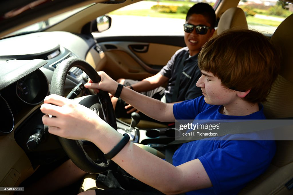 Blind Student Jake Cohen Right Gets Driving Instruction From Head