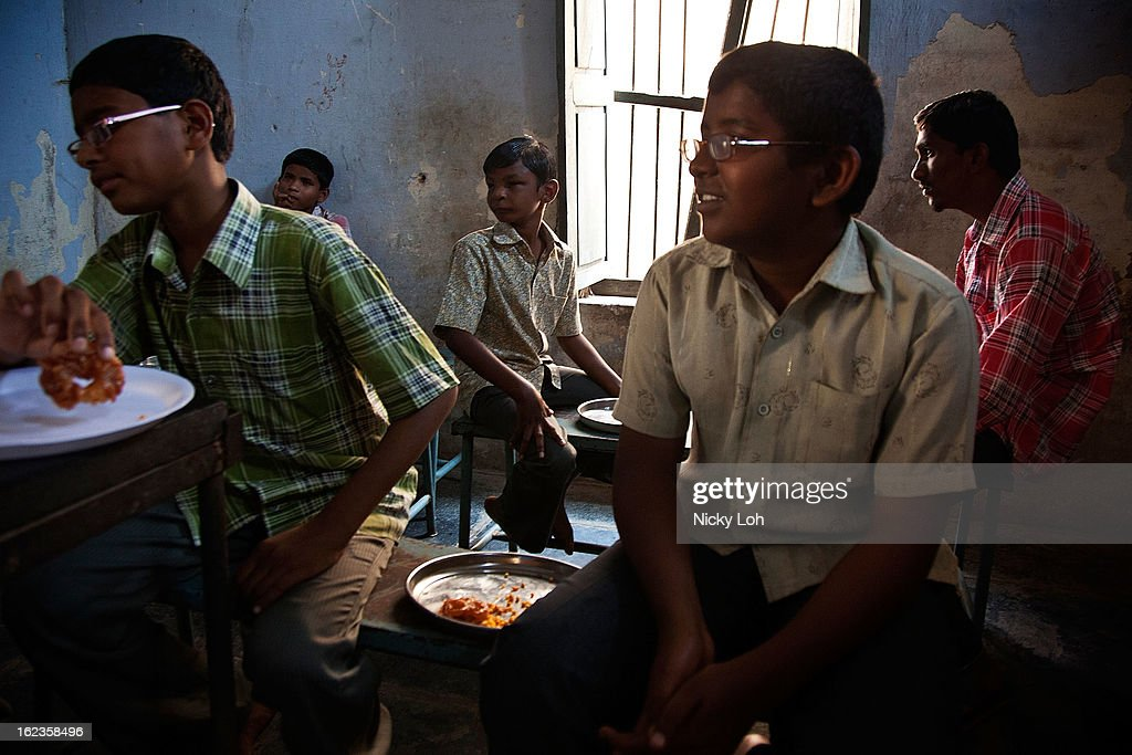 Blind student wait for lunch at the Government High School for The Blind on February 22, 2013 in Kadapa, India. The school which is funded by the government looks after 50 visually impaired or blind students. India has the largest number of people with visual impairment globally. According to the World Health Organization (WHO), an estimated 63 million people in India are visually impaired, and of these approximately 8 million people are blind.