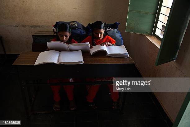 Blind students attend a lesson at the Government High School for The Blind on February 22 2013 in Kadapa India The school which is funded by the...