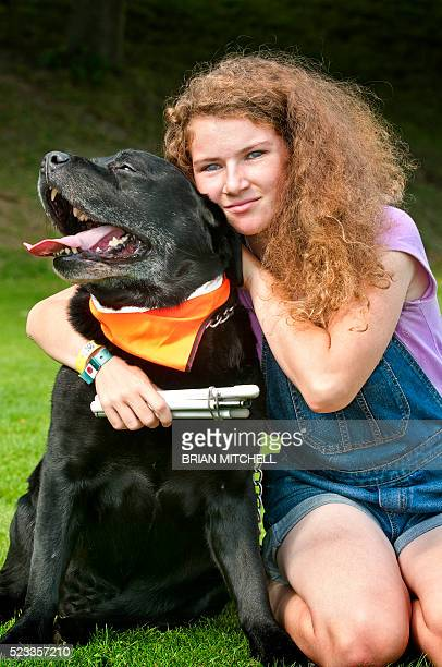 Blind teenage girl with her guide dog