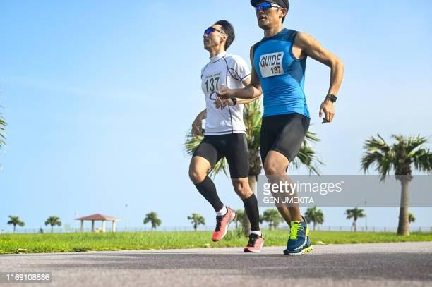 blind triathlete - marathon stock pictures, royalty-free photos & images