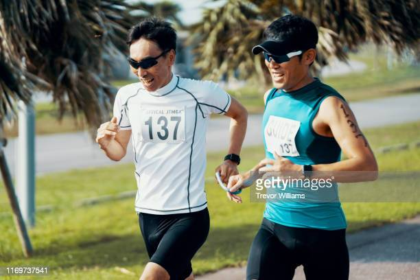 blind triathlete running and training with his guide - disabilitycollection stock-fotos und bilder