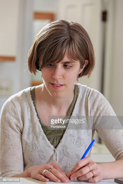 blind woman signing documents with a pen - cegueira imagens e fotografias de stock
