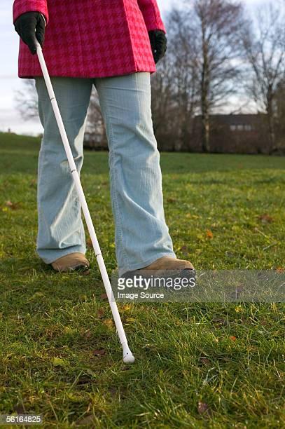 blind woman using a cane - 白杖 ストックフォトと画像