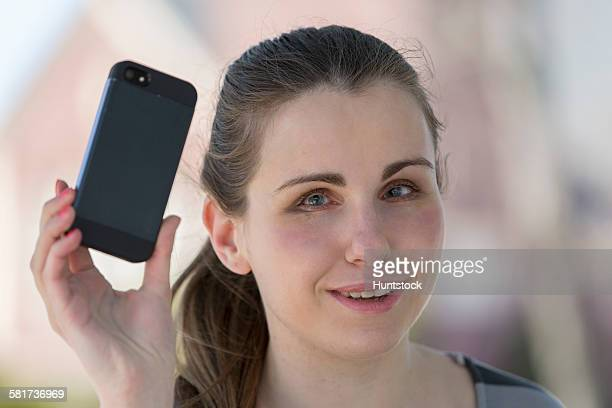 Blind woman using her assistive technology to listen to her texts