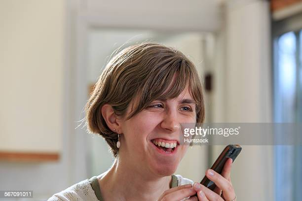 Blind woman using her cell phone